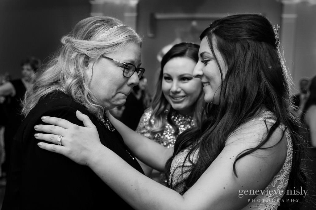 A mother's emotional reaction to dancing with her daughter on her wedding day.