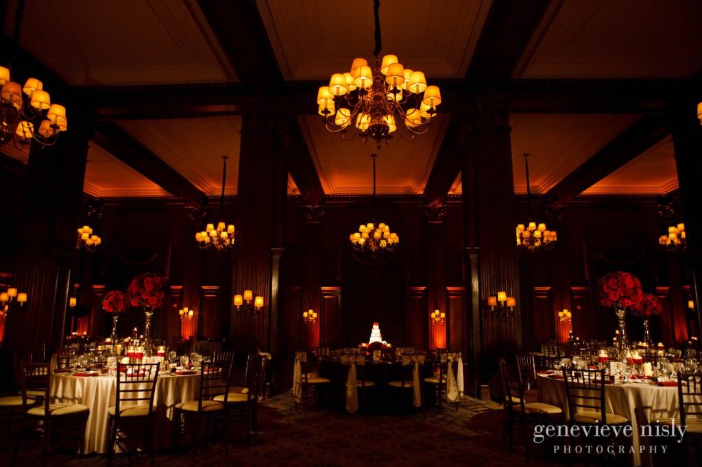 A Union Club Cleveland wedding reception setup with floral and lighting decor.