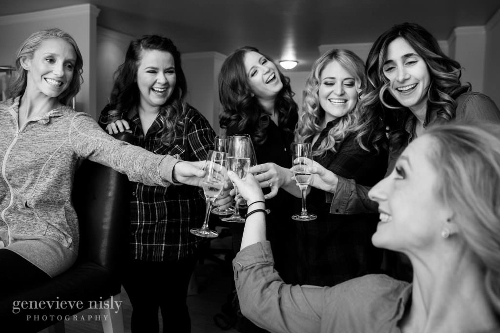 Brides gives a toast with her bridesmaids while getting ready for her wedding at the Ritz Carlton in Cleveland.