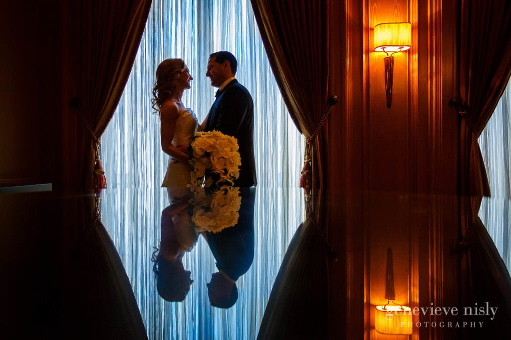 Bride and groom framed in front of a window at the Ritz Carlton in Cleveland.