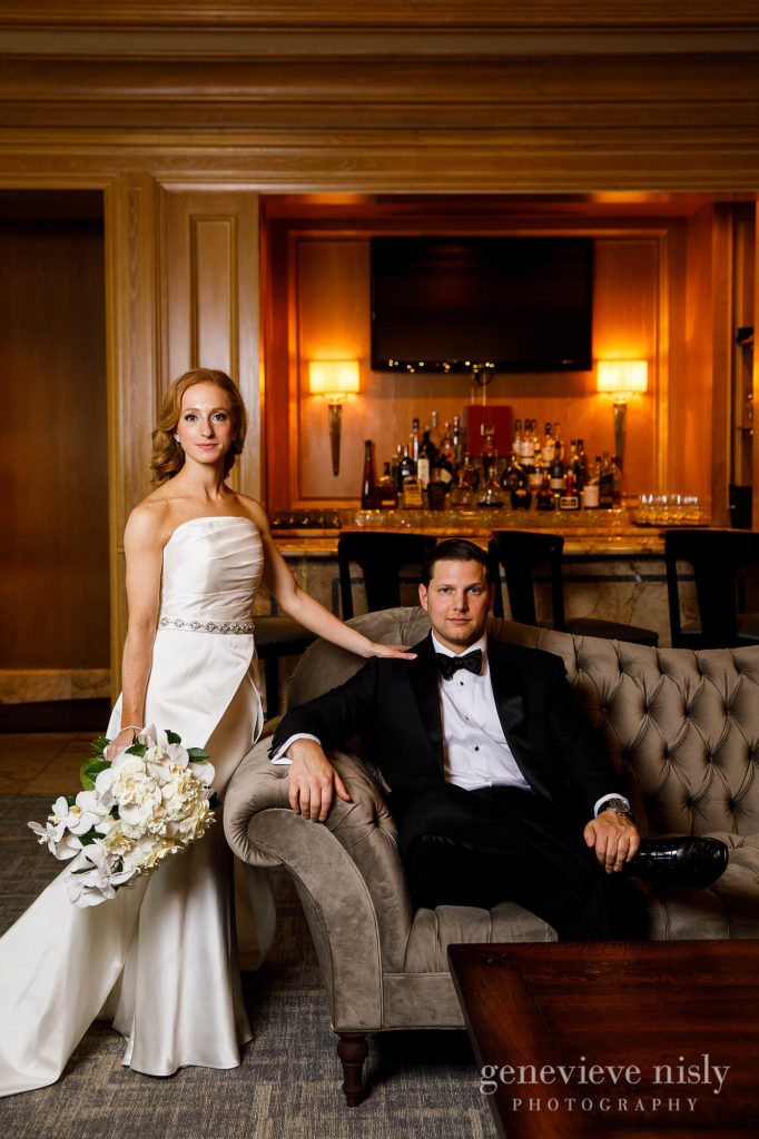 Bride and groom pose for a portrait in the lobby of the Ritz Carlton Hotel in Cleveland.