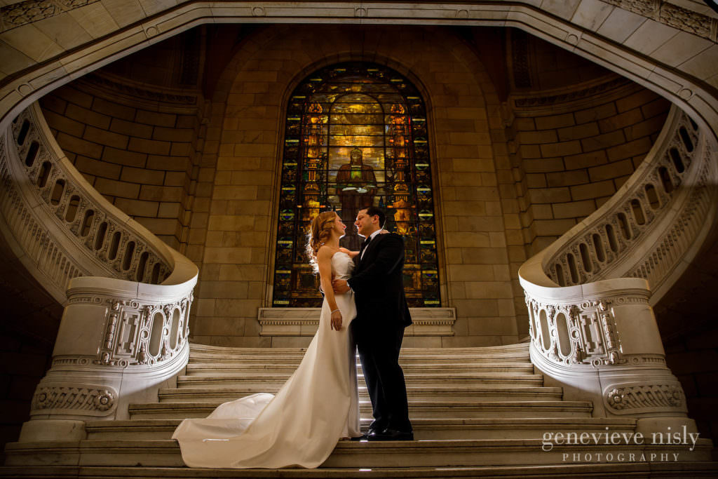 Wedding couple on the grand staircase at the old courthouse in Cleveland.