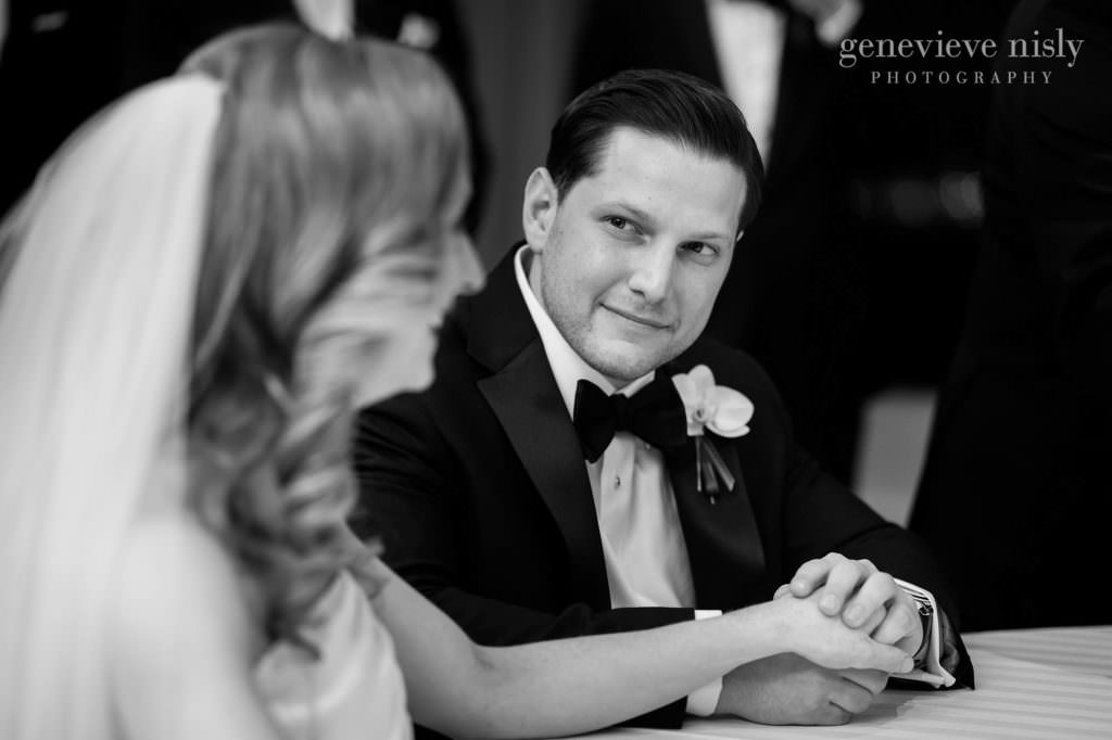 Max looks at Dana while holder her hand during the katubah signing.