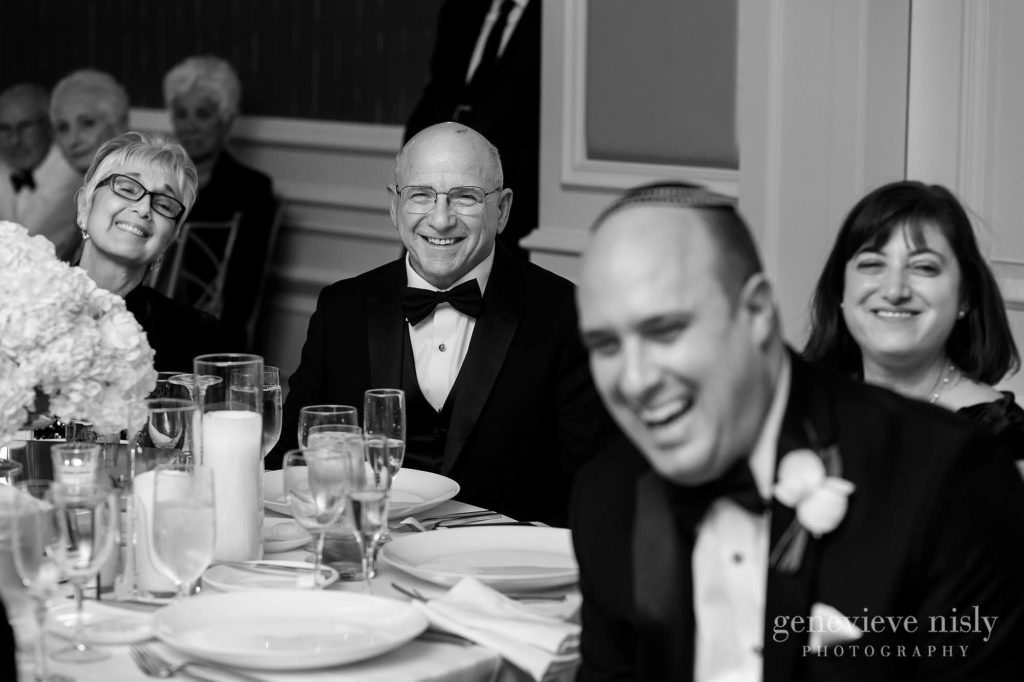 Family members react during the toasts at the reception.