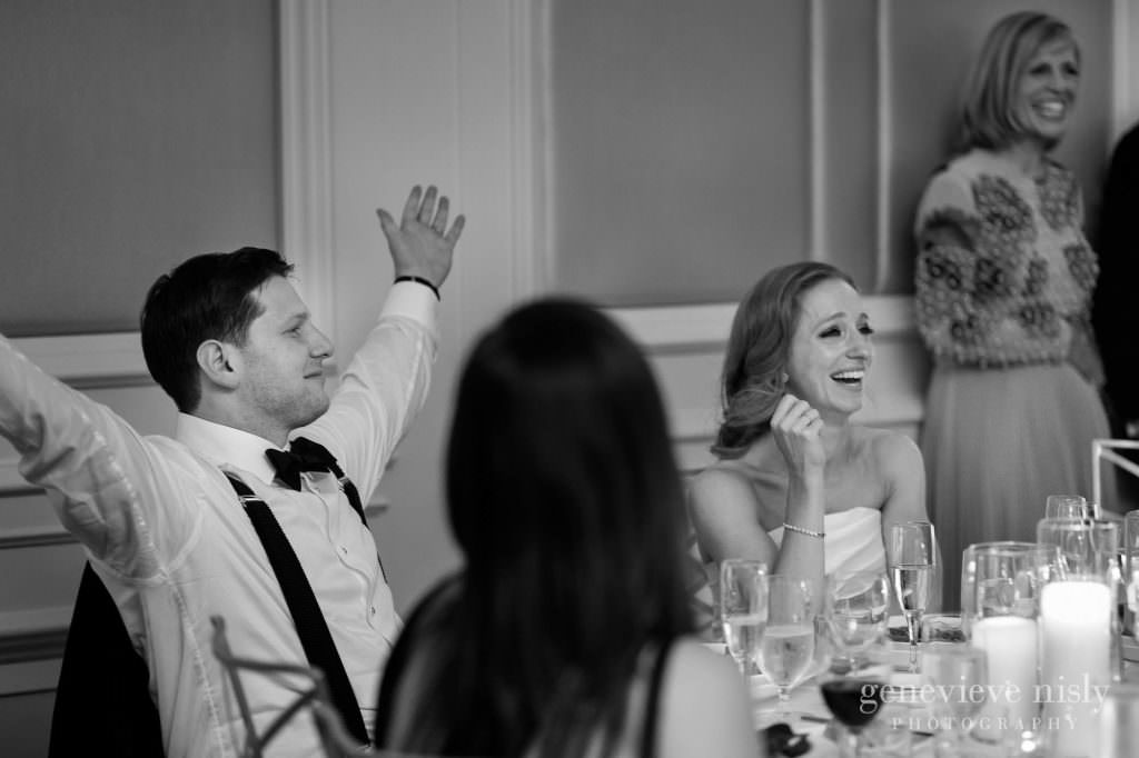 Max and Dana react to the toasts during the reception.