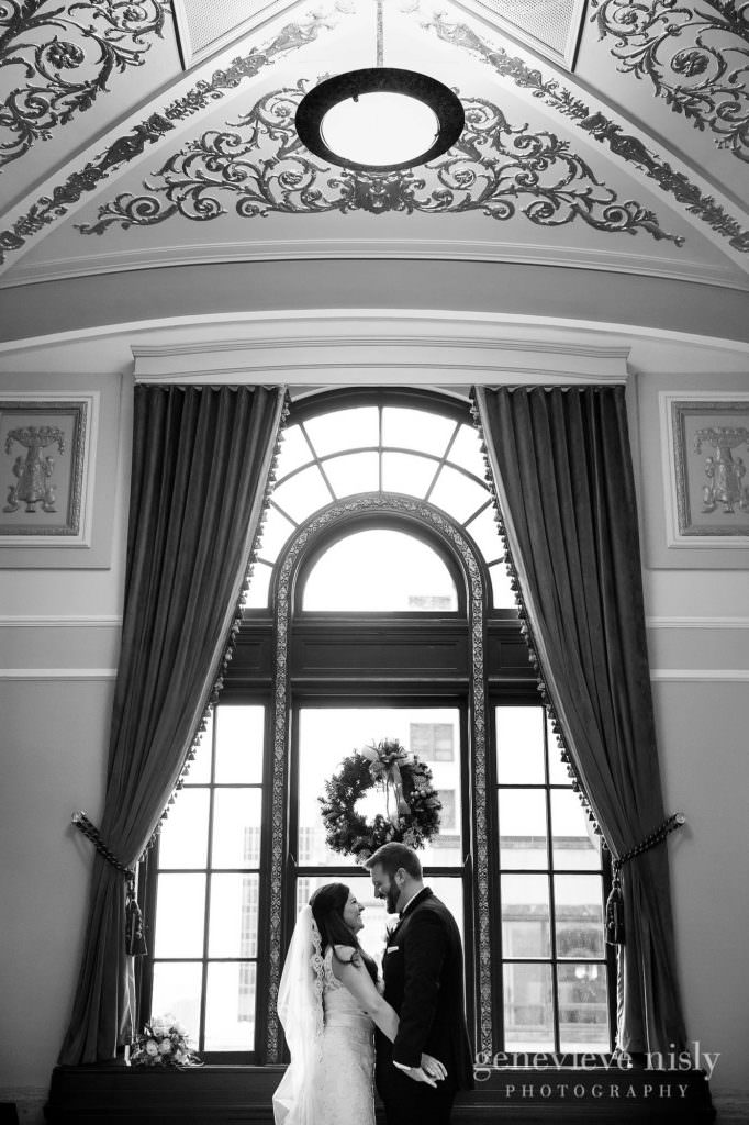 Bride and Groom backlit buy a window at the Onesto Lofts.