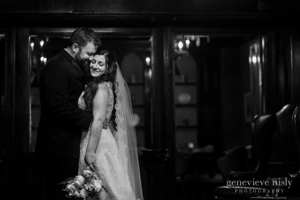 Black and White of the wedding couple embracing at the Canton Club.