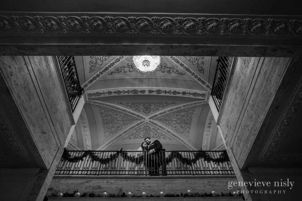 Bride and groom in the grand staircase at their Onesto Lofts wedding.