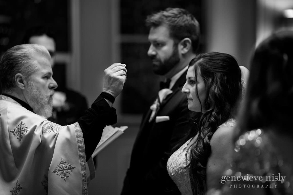 A ring blessing during the Greek wedding ceremony.