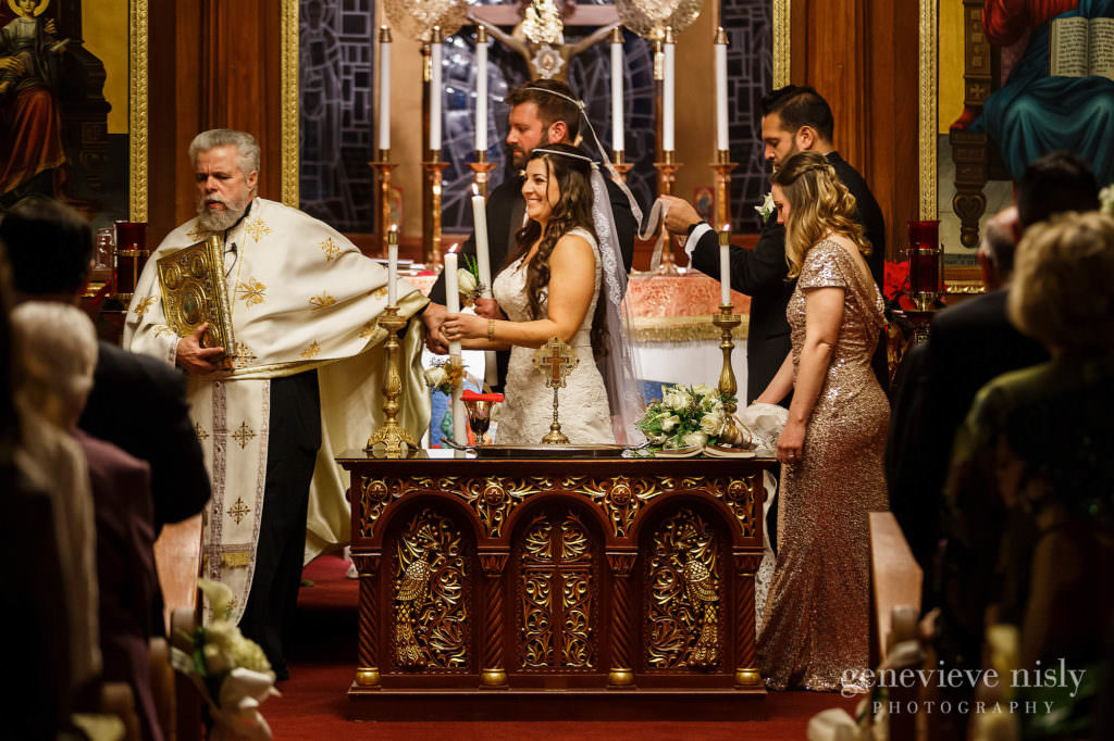 Bride and groom circle the alter during the Greek wedding ceremony at St. Haralambos Church in Canton, Ohio.