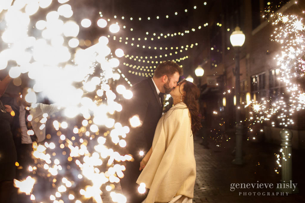 Bride and groom kiss during their sparkler exit.