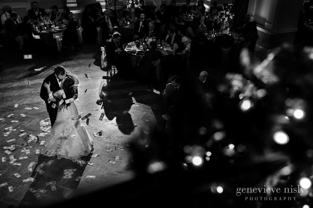 Bride and groom kiss during their first dance at the reception.