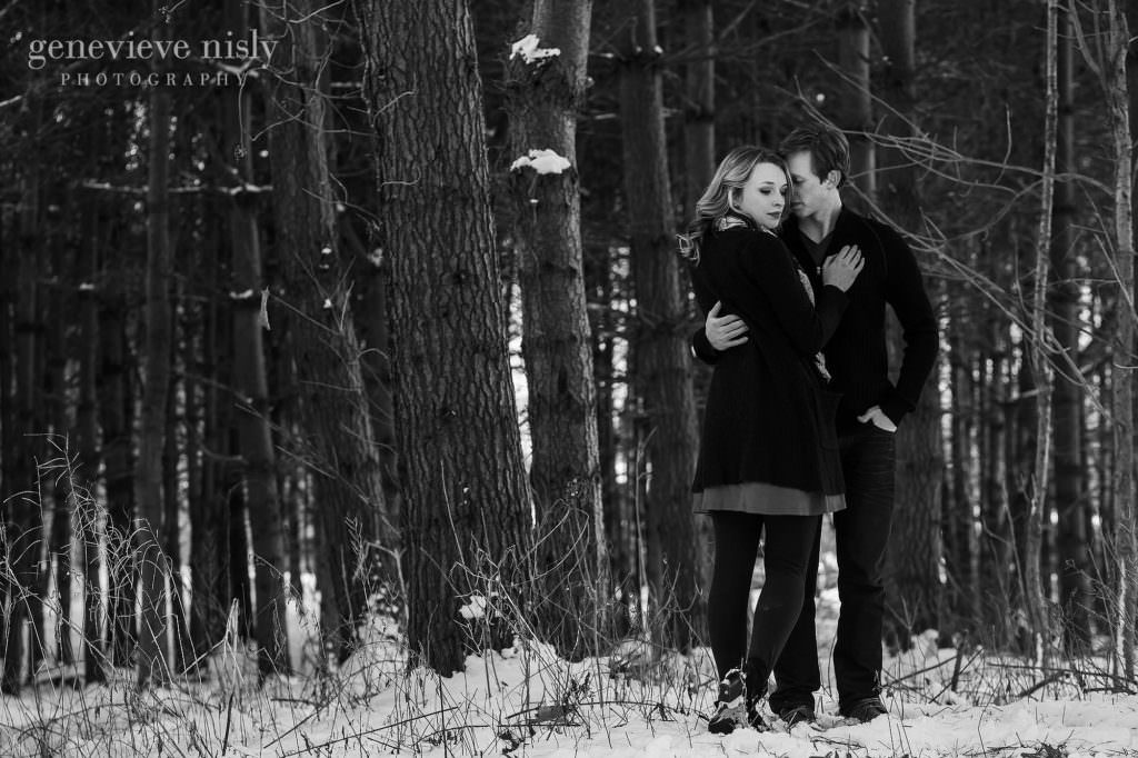 Michael and Jacee in front of evergreens during their winter engagement  session.
