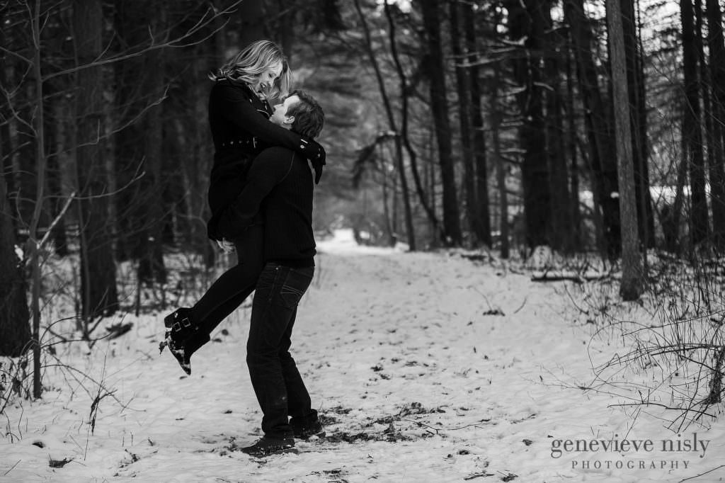 Michael spins Jacee during their Beottler Park engagement session in Green, Ohio.