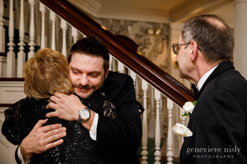 The groom hugs his parents before walking down the aisle at Mooreland Mansion.