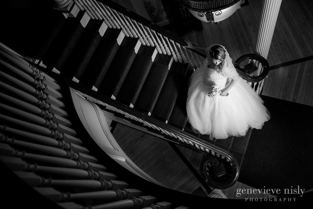 The stunning bride on the dramatic staircase at Mooreland Mansion.