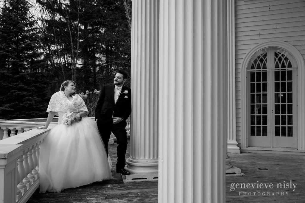 The bride and groom are posing for some portraits on their wedding day at Mooreland Mansion.