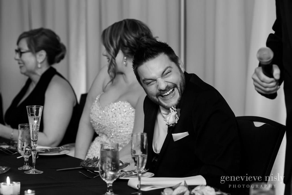The groom laughs at the wedding toast given in his honor at the Cleveland Holiday Inn.