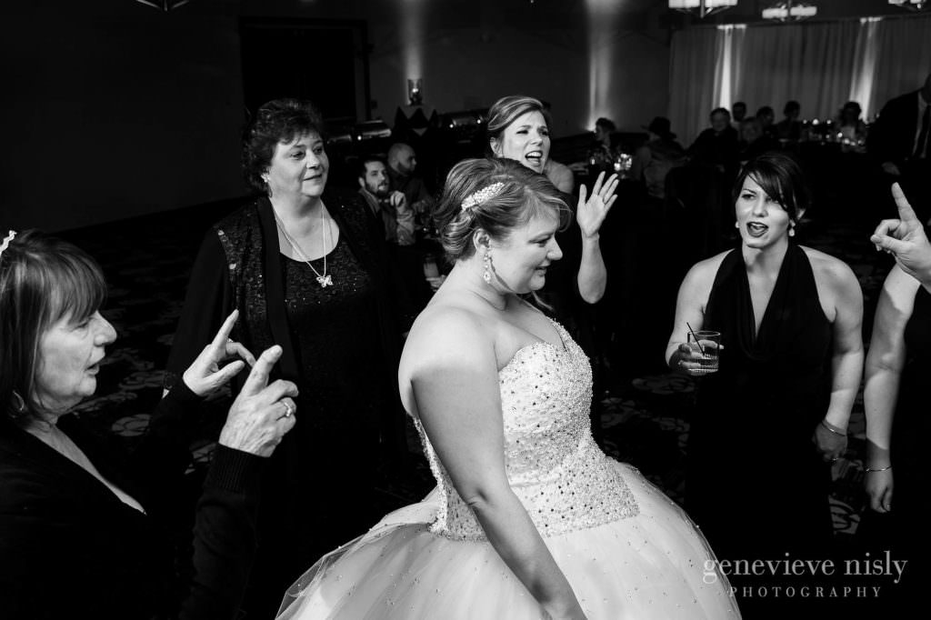 The bride shares a dance with friends at her Cleveland wedding reception.