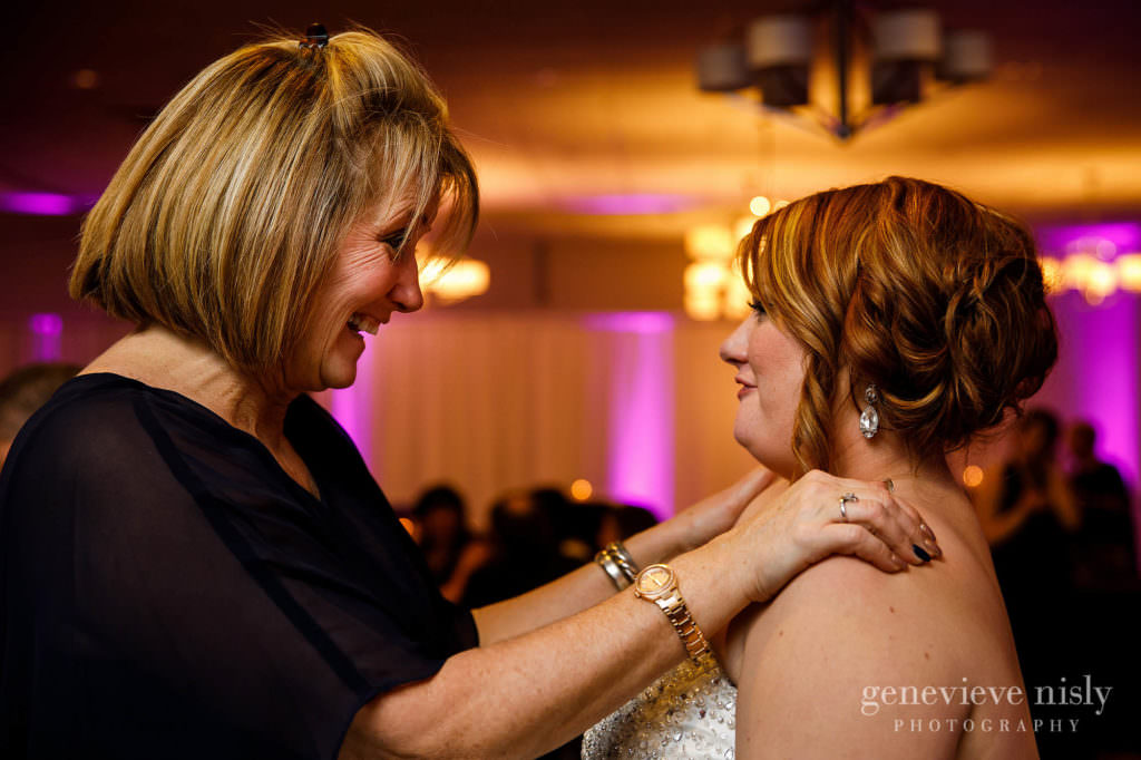 The bride enjoys a fun conversation with guests during her Cleveland wedding reception.