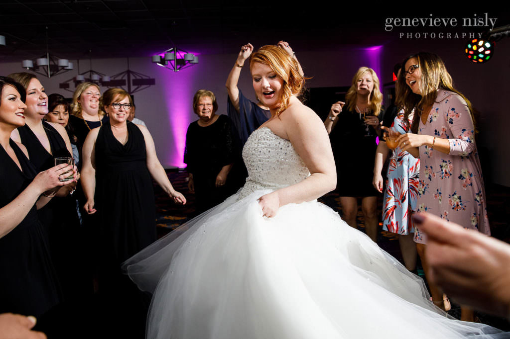 The bride is twirling on the packed dance floor of her wedding at the Cleveland Holiday Inn.