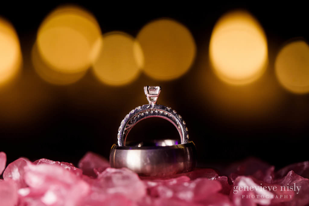 The bride and groom's wedding rings are expertly photographed at the Holiday Inn in Cleveland Ohio.