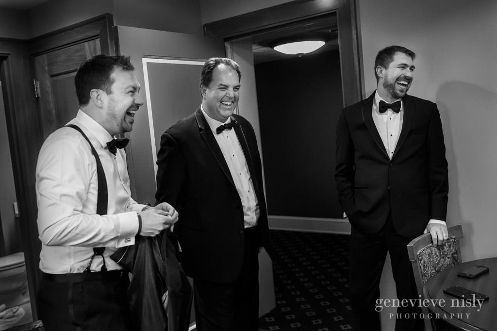 Groom and his groomsmen share a laugh.