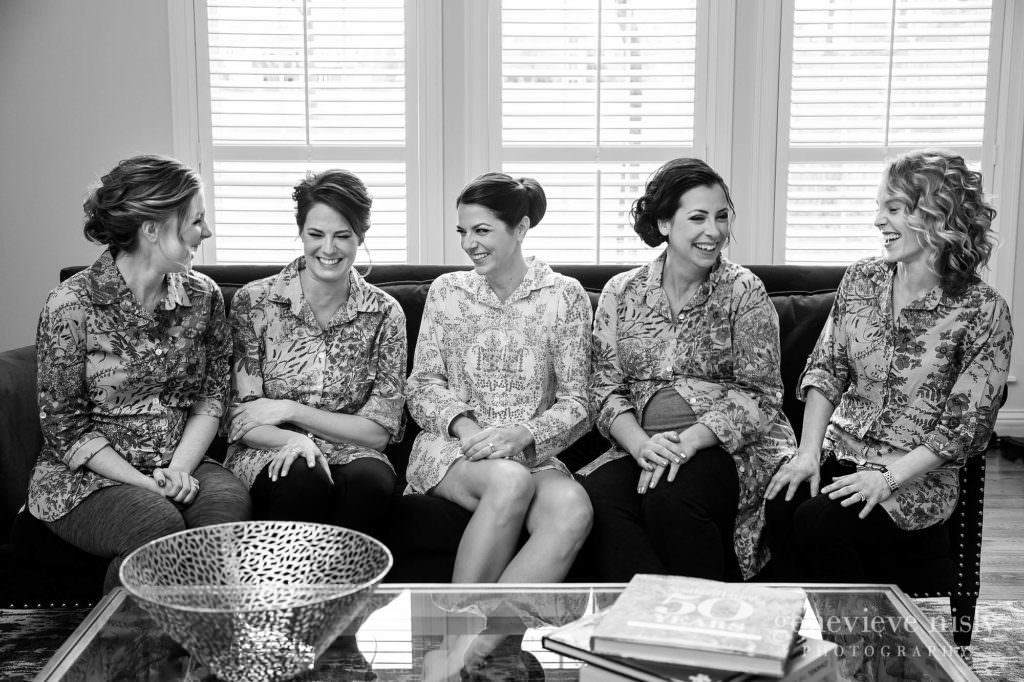 A bride and her bridesmaids share a laugh.