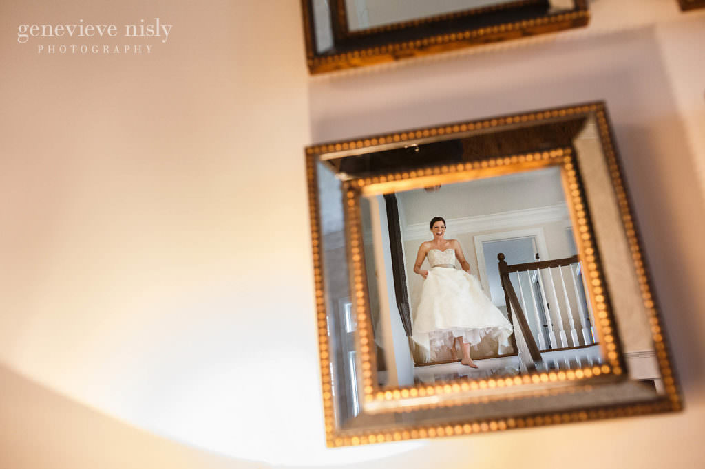 The bride walks down the stairs.
