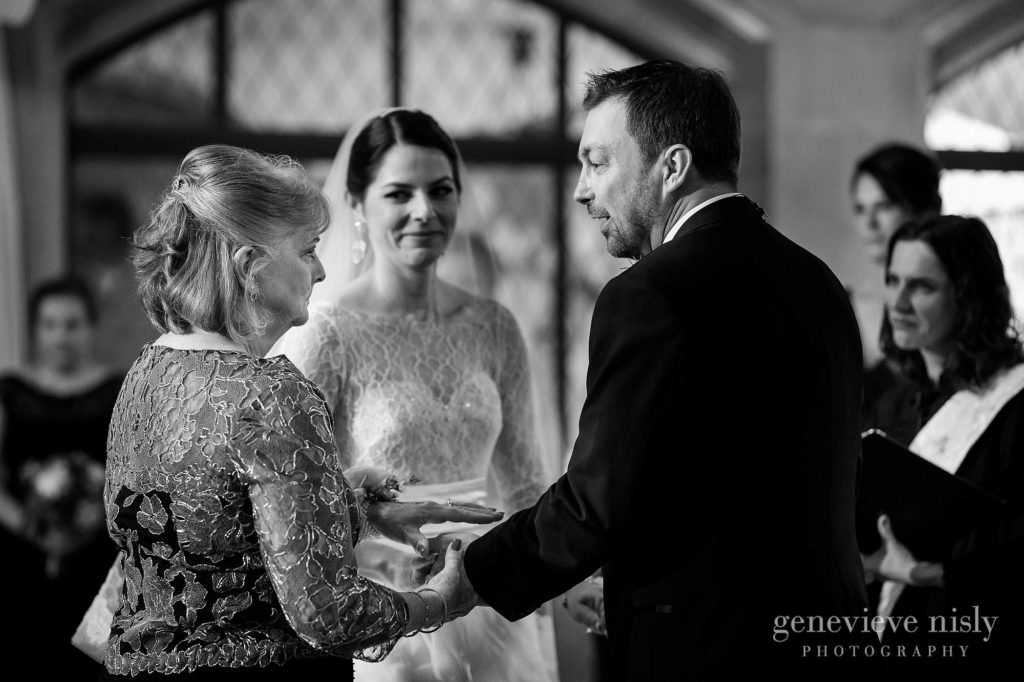 The groom greets the mother of the bride during the ceremony.