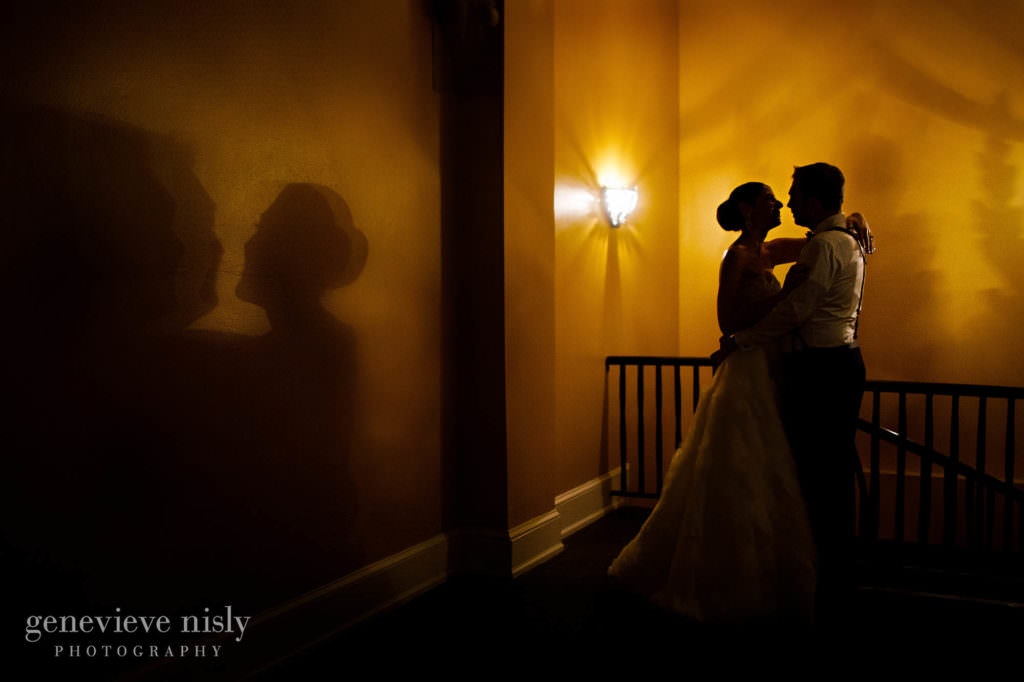 Bride and groom cast a shadow on the wall at their reception.