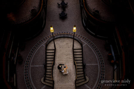Natalya and Cameron dance on the grand staircase during their wedding at the Hyatt Arcade in Downton Cleveland, Ohio.