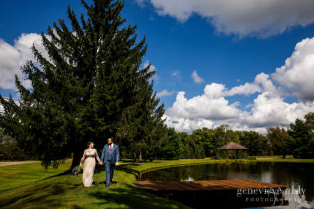 Chris and Nicole take a walk near the lake during the Meadow Ridge Farm wedding in Cleveland, Ohio.