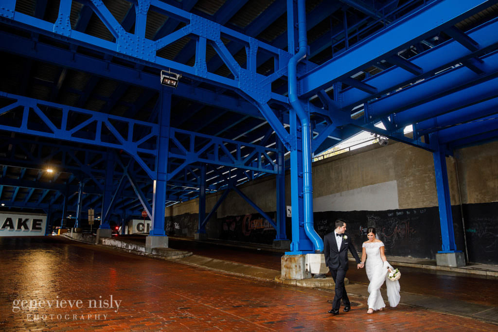 Grace and Billy escape the rain under the blue bridge on their wedding day in Cleveland, Ohio.