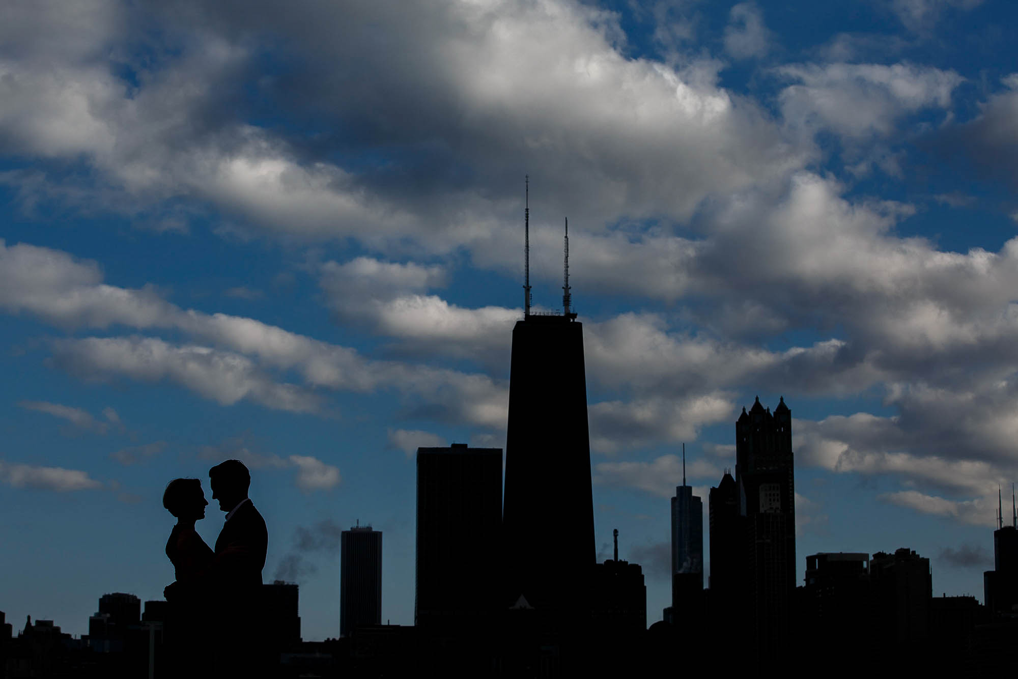 Silhouette of bride and groom against the Chicago skyline.