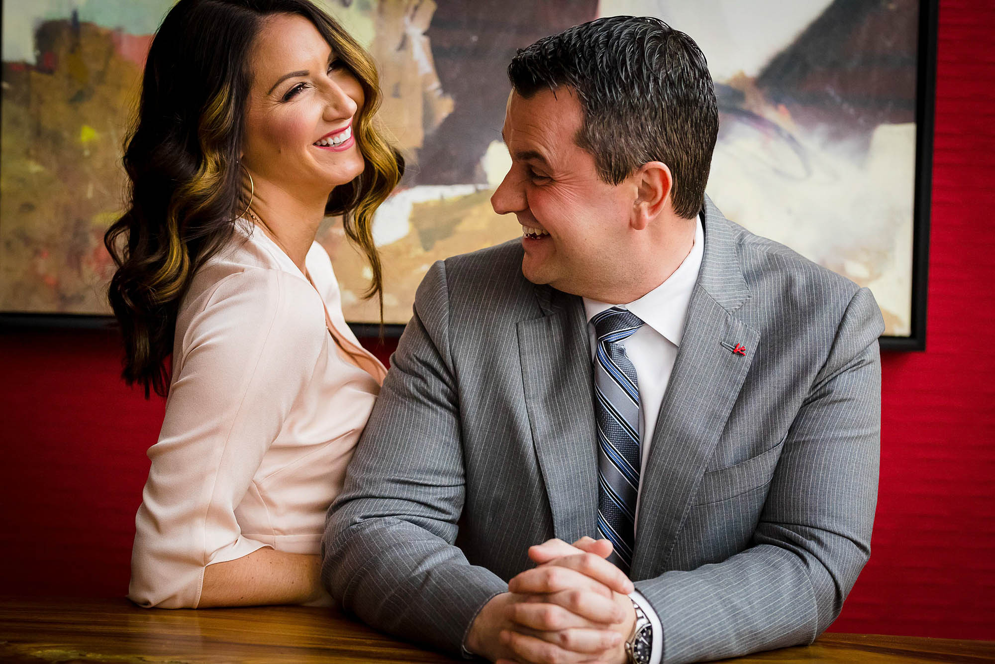 Woman laughs at her fiancé during their engagement photo session in Cuyahoga Falls.