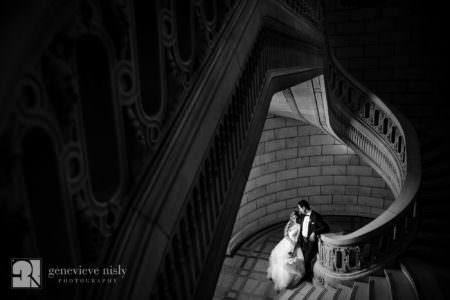 Navid and Melissa at the bottom fo the grand staircase during their Persian wedding at the Old Courthouse in Cleveland, Ohio.