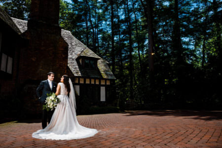 Brian and Allison in her custom Radiant Bride wedding dress during their wedding at the Club at Hillbrook.