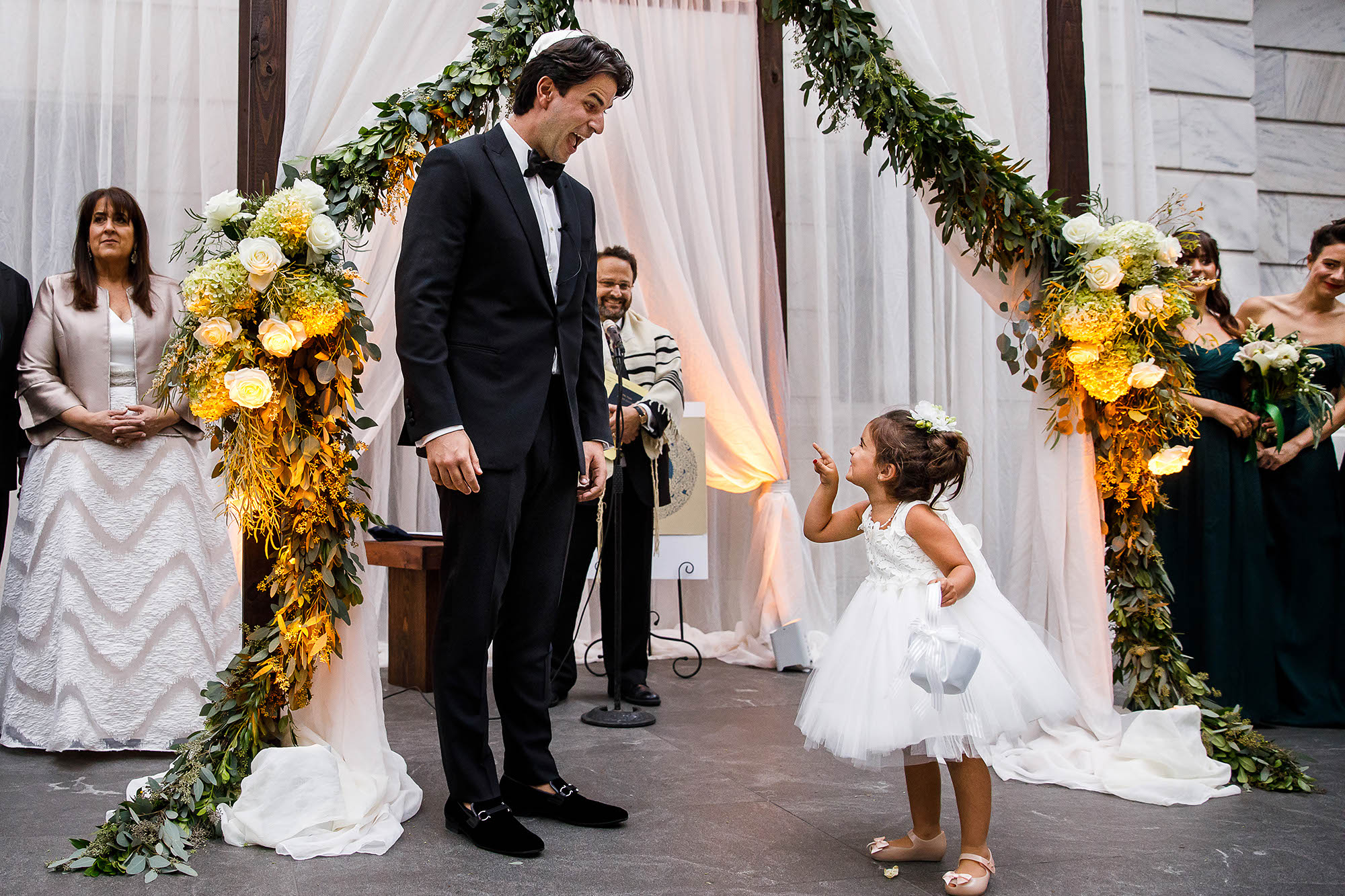 Flower girl scolds the groom after her walk down the aisle during this wedding at the Cleveland Museum of Art.