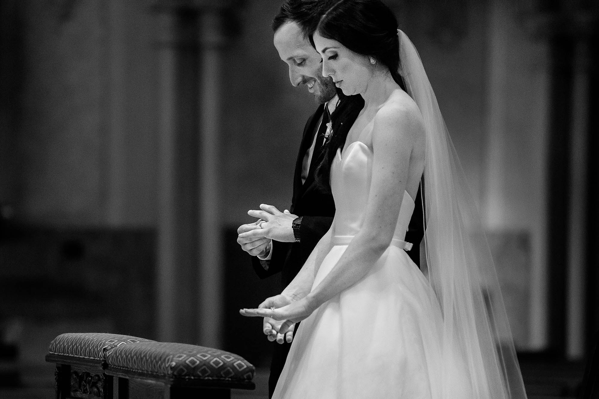Liz and Mike both check out their brand new wedding bands during their Catholic wedding mass at St. John's Cathedral in Cleveland.