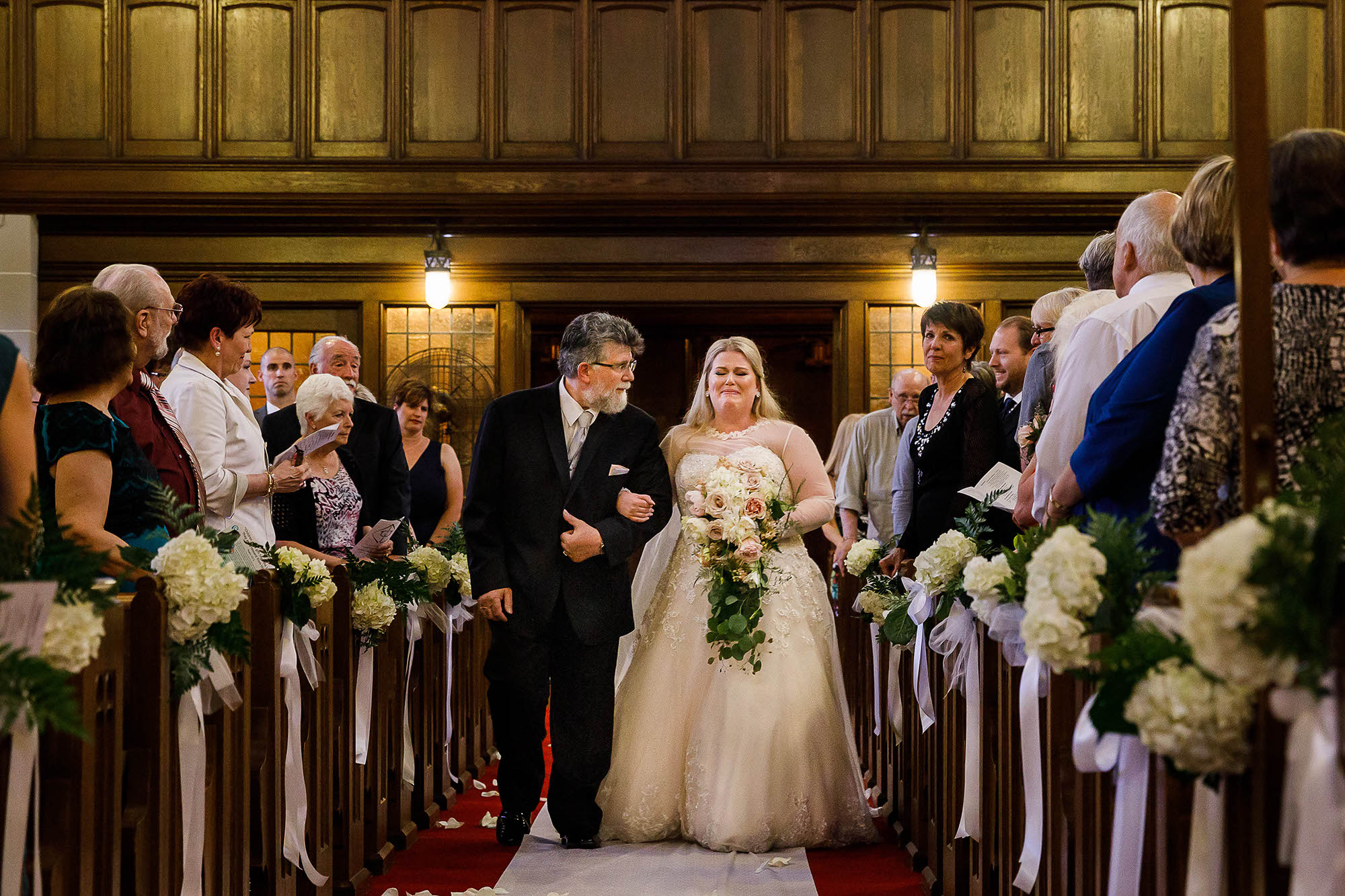 An emotional moment as the bride is escorted down the aisle by her father in Akron, Ohio.
