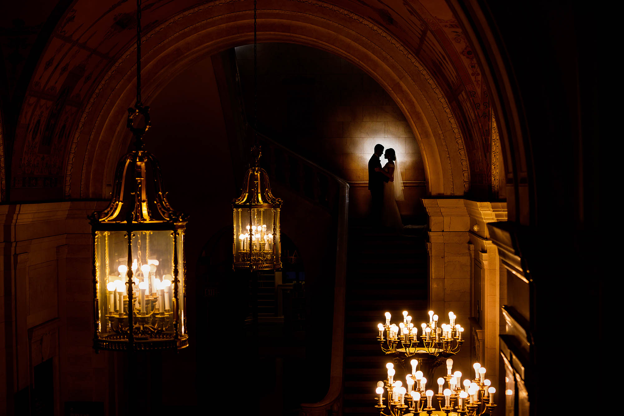 A dramatic environmental wedding day portrait on the stairs of the Cleveland Public LIbrary.