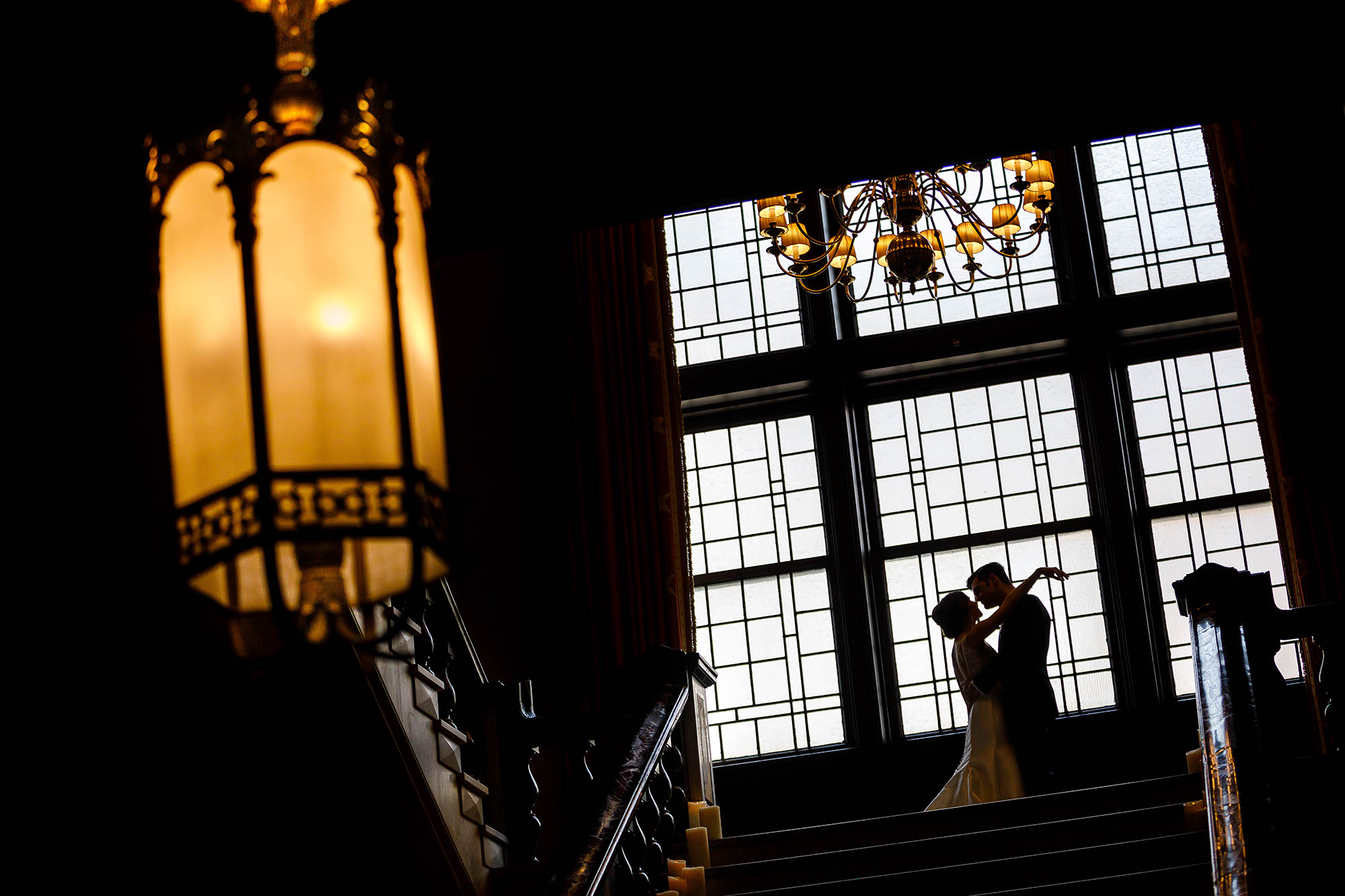 The grand staircase of The Union Club is an amazing photo location with the large windows and chandeliers.