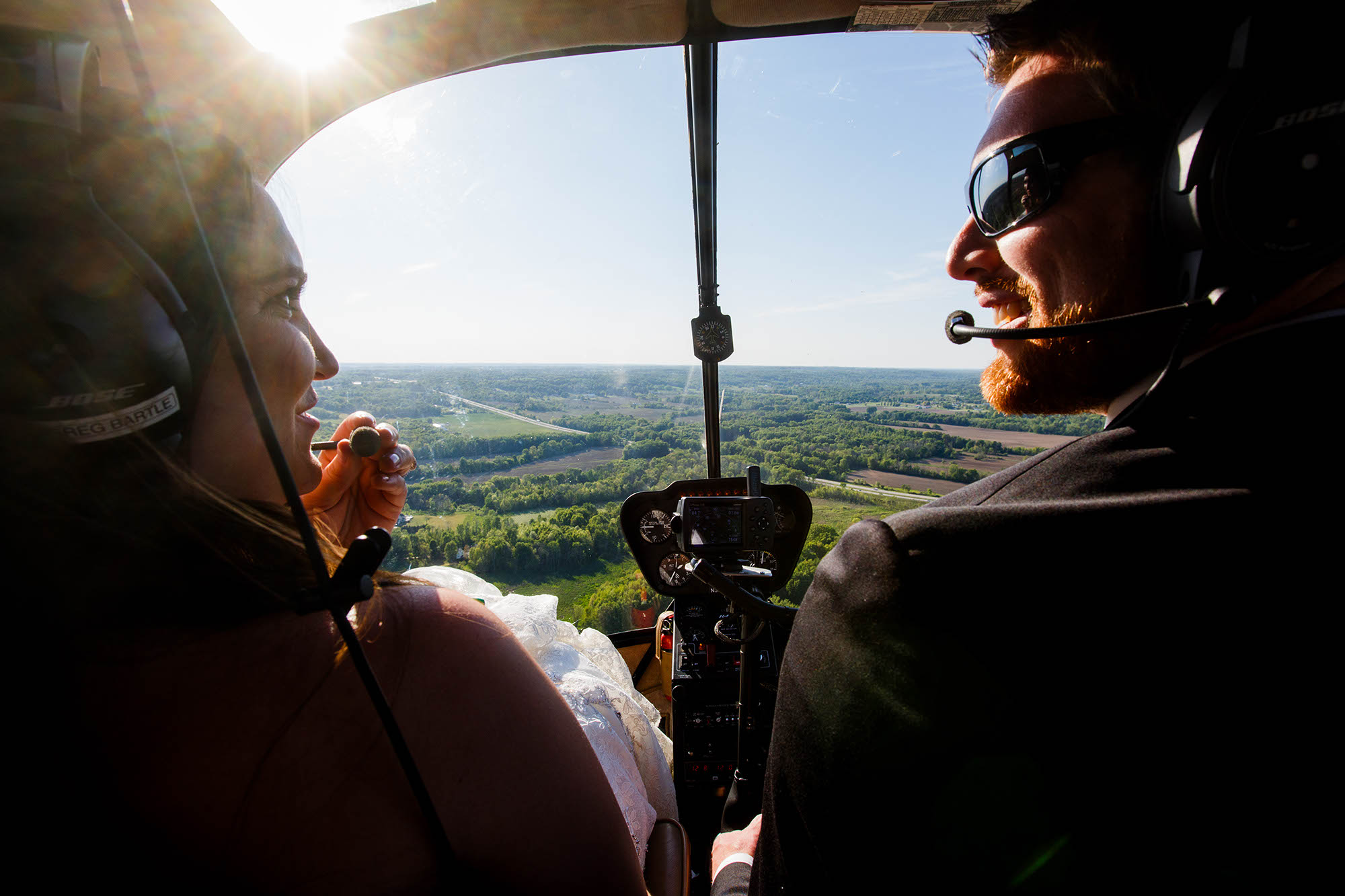This groom took his bride on a helicopter ride on a helicopter ride to their reception on their wedding day on Westfield, Ohio.