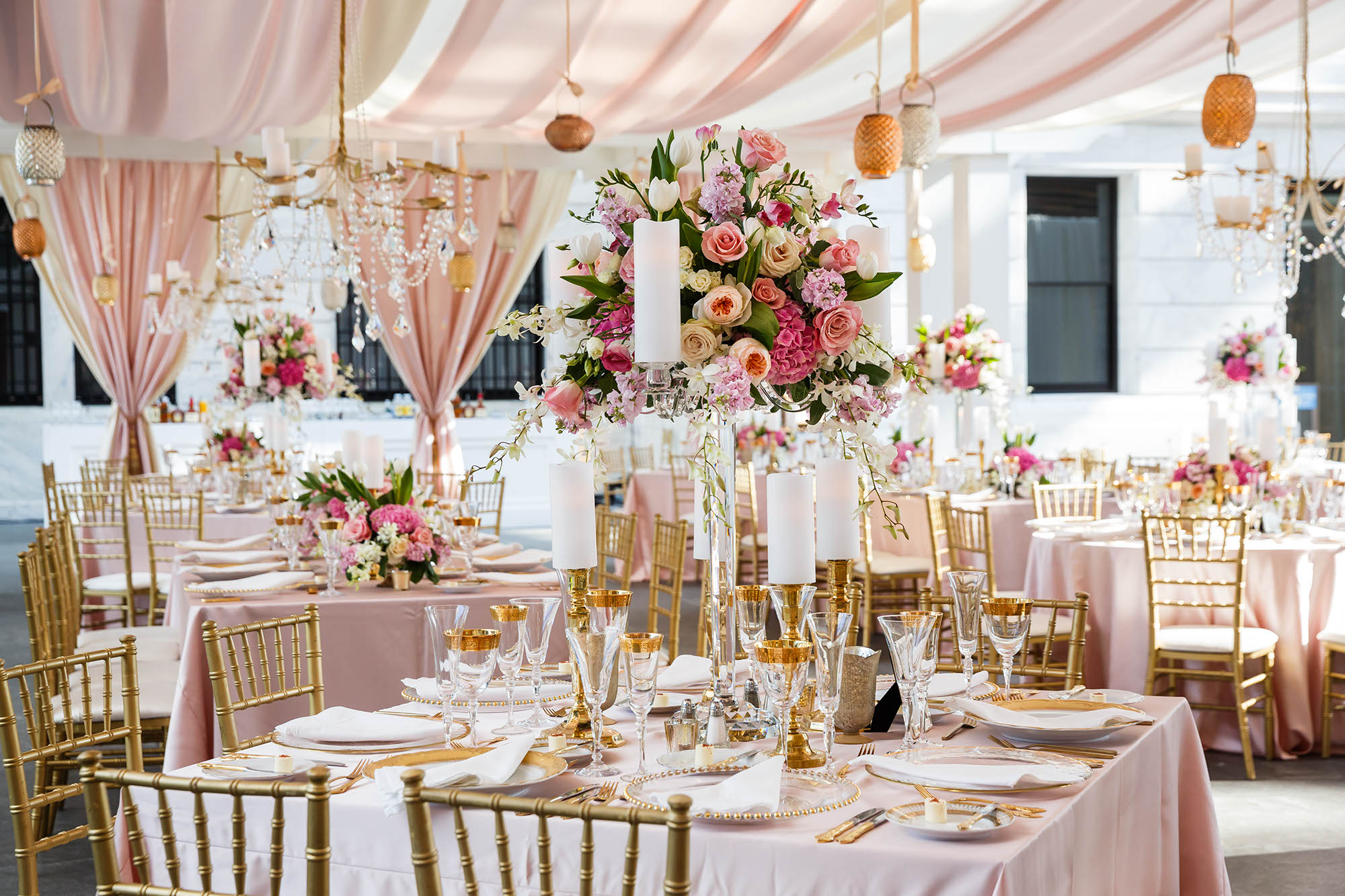 A wedding reception at the Cleveland Museum of Art decorated in pinks, magenta, white and gold.